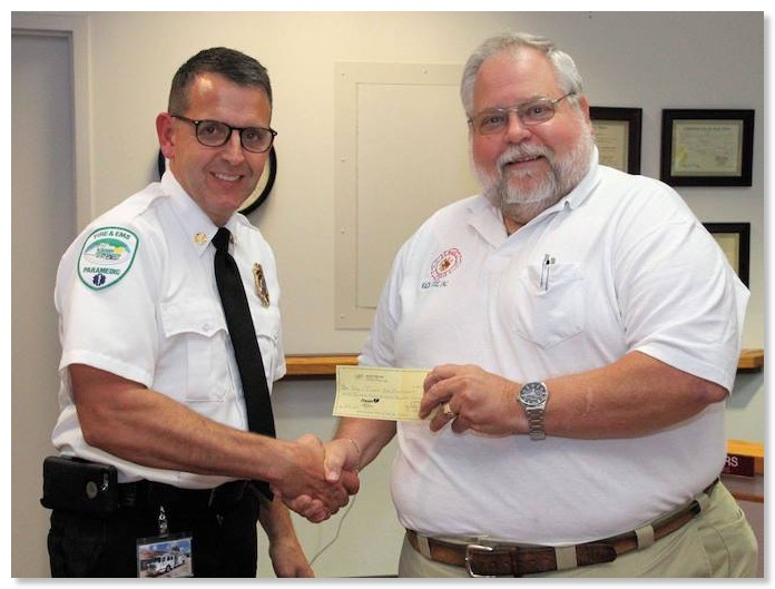ed presents check to chief